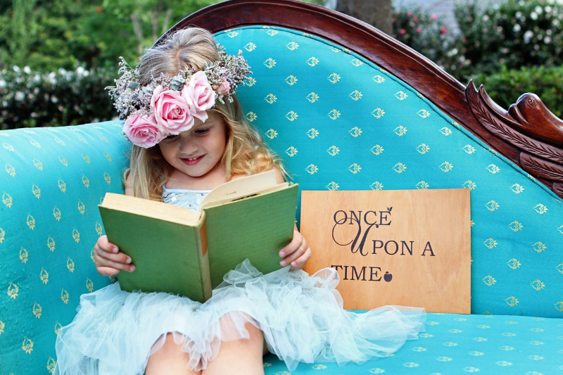 once-upon-a-time-ever-green-gardens-wedding-venue-flower-girl-story-time-2